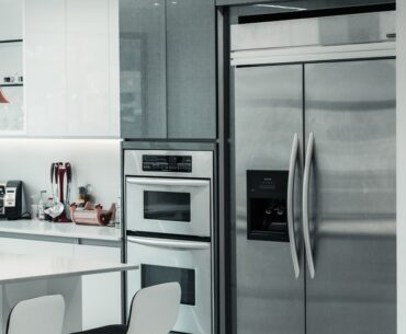 can a fridge go next to an oven